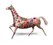 Cavalo do brinquedo com o ornamento isolado no branco Imagens de Stock