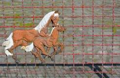 Cavalos bonitos no metal, cerca Imagens de Stock Royalty Free