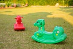 Cavalos de balanço plásticos Imagens de Stock Royalty Free