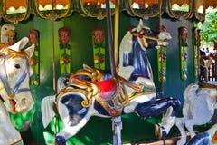 Cavalos do carrossel do parque de diversões Fotografia de Stock