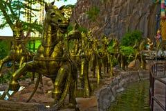 Cavalos dourados em cavernas Gombak Selangor Malásia de Batu imagens de stock royalty free