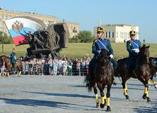 The cavalry honorary escort of the Presidential Regiment speaks against the background of the monument to the heroes of the First. MOSCOW, RUSSIA - AUGUST 22 Royalty Free Stock Images