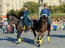 The cavalry honorary escort of the Presidential Regiment speaks against the background of the monument to the heroes of the First Stock Images
