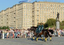 The cavalry honorary escort of the Presidential Regiment speaks against the background of the monument to the heroes of the First. MOSCOW, RUSSIA - AUGUST 22 Royalty Free Stock Image
