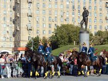 The cavalry honorary escort of the Presidential Regiment speaks against the background of the monument to the heroes of the First Royalty Free Stock Photo