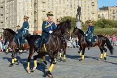 The cavalry honorary escort of the Presidential Regiment speaks against the background of the monument to the heroes of the First Stock Photo