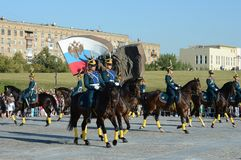 The cavalry honorary escort of the Presidential Regiment speaks against the background of the monument to the heroes of the First. MOSCOW, RUSSIA - AUGUST 22 Stock Photography