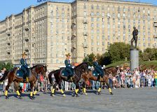 The cavalry honorary escort of the Presidential Regiment speaks against the background of the monument to the heroes of the First. MOSCOW, RUSSIA - AUGUST 22 Royalty Free Stock Photography