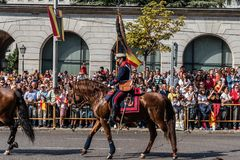 Cavalry marching in Spanish National Day Army Parade. Madrid, Spain - October 12, 2017: Calvary marching in Spanish National Day Army Parade. Several troops take Royalty Free Stock Photography