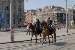 Cavalry police. Amsterdam, Netherlads, 30th April 2012. Cavalry policemen inspect the center of the Amsterdam at the Queen's day celebration Royalty Free Stock Images