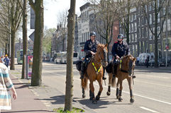 Cavalry police. Amsterdam, Netherlads, 30th April 2012. Cavalry policemen inspect the center of the Amsterdam at the Queen's day celebration Stock Photography