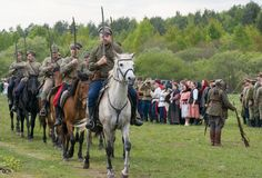 Cavalry soldiers ride on horses with naked swords royalty free stock image