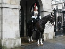 A cavalryman of Blues and Royals cavalry regiment on duty at entrance to  Horse Guards in  London, UK. stock images