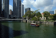 Cavanagh Bridge in Singapore. View of the Finance District and the river Stock Images