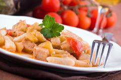 Cavatelli with swordfish and eggplant. Stock Photography