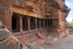 Cave 1 : Facade. Badami Caves, Karnataka, India. Depicting Carvings Of Dwarfish Ganas, With Bovine And Equine Heads, In Different Stock Images