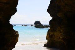 Cave along tropical coast Royalty Free Stock Image