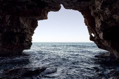 Cave of the arches in the cove of Moraig. Stock Images