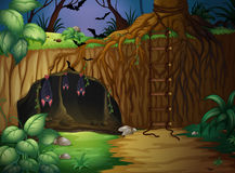 A cave and bats. Illustration of a cave and bats in a beautiful forest Royalty Free Stock Photography