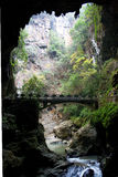 Cave with bridge. Bridge across a river in a cave in Jiuxiang, Yiliang, Yunnan, China Royalty Free Stock Images