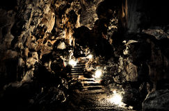 The cave. Brightness in the dark cave Stock Photo