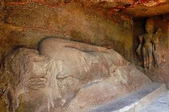 Cave 9, Buddha in Parinirvana with four-armed Avalokitesvara. Aurangabad Caves. Maharashtra, India Stock Photo