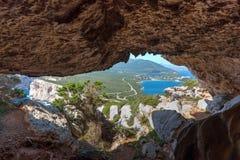 Cave in Capo Caccia coastline Stock Photography
