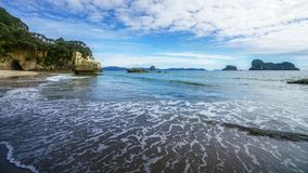 The cave of the cathedral cove beach,coromandel,new zealand 2. Sand, water, trees and the cave of the cathedral cove beach,coromandel,new zealand Royalty Free Stock Photography