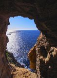 Cave on Cavalleria Cape of Minorca Stock Photo
