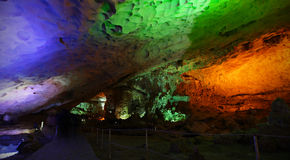 Cave or cavern with colorful lights open for tourism Royalty Free Stock Photo