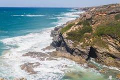 Cave in the Cliffs on the beach,  Vila Nova de Milfontes. Alentejo, Portugal Stock Photo