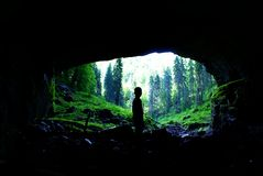 Cave Coiba Mare in Apuseni Mountains,Romania. Cave portal Coiba Mare, near Village Casa de Piatra ,whose size is 47 meters high and 74 meters breadth,in the Royalty Free Stock Images