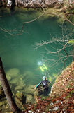 A cave diver emerges from a spring Royalty Free Stock Image