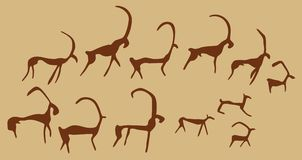 Cave Drawings Of Ancient Animals. Twelve silhouette images of animals painted on a wall in a cave Stock Photography