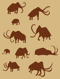 Cave Drawings Of Ancient Mammoths. Ten silhouette images of ancient mammoths painted on a wall in a cave Royalty Free Stock Photography