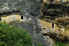Cave dwelling. Medieval cave dwelling in a cliff in dordogne in france Stock Photo