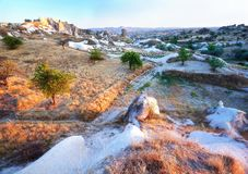 Cave Dwellings in an Arid Landscape in Cappadocia stock images