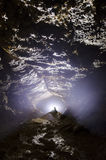 Cave entracne with light and stalagmite Stock Photo