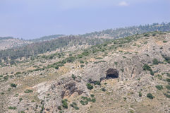 Cave entrance in the mountain Stock Image
