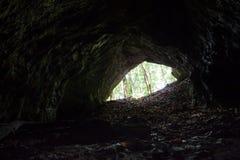 Cave entrance on sunny day Stock Photos
