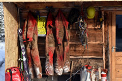 Cave exploration equipment hanged on a wooden cabin Royalty Free Stock Images