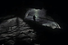 Cave Exploration. Exploration in a raw cave Stock Photo