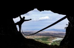 Climbing with rope in the cave Stock Photos