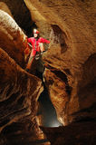 Cave explorer in action. Wind cave, Romania Royalty Free Stock Image