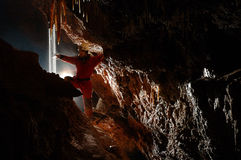 Cave explorer, speleologist exploring the underground Royalty Free Stock Images
