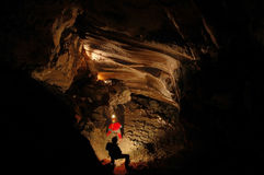 Cave explorers, speleologists in the cave Royalty Free Stock Photo