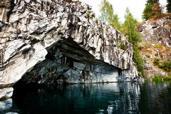 Cave in flooded marble quarry in Karelia Royalty Free Stock Images