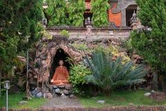 The cave and garden in Brahmavihara Arama monastery, Bali Island (Indonesia) Royalty Free Stock Photography