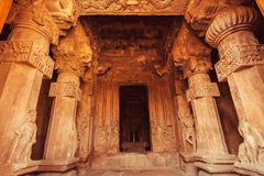 Cave hall with carved columns inside the traditional Hindu temple. Pattadakal, 7th century artworks of India. UNESCO World Heritage site stock images