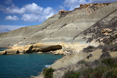 Cave and Hills at Gnejna Bay. A secluded bay in Malta showing the geology of the Island Stock Photos